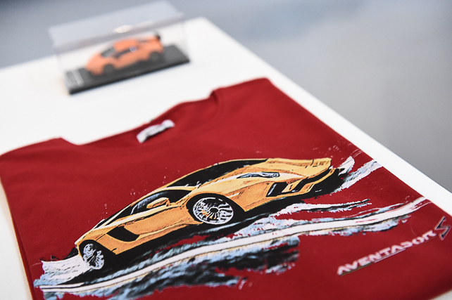 MILAN, ITALY - JANUARY 14: Items of clothing by Collezione Automobili Lamborghini FW 2018/19 are displayed during Collezione Automobili Lamborghini and the Super Suv Urus cocktail party held at Tortona 32 as part of Milan Men's Fashion Week Fall/Winter 2018/19 on January 14, 2018 in Milan, Italy. (Photo by Stefania M. D'Alessandro/Getty Images for Lamborghini)
